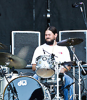 Mia Borders with Pablo Gonzalez (Bass), Hick Hingel (Drums) and Kyle Sclafani (Lead Guitar) at Voodoo Fest 2010 in New Orleans.