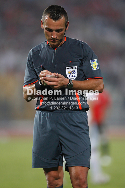 CAIRO - SEPTEMBER 28:  Referee Ivan Bebek completes a booking during a FIFA U-20 World Cup soccer match between Paraguay and Egypt September 28, 2009 in Cairo, Egypt.  (Photograph by Jonathan P. Larsen)