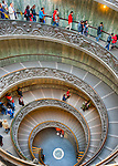 Tour groups venture down the famous spiral steps in the Vatican Museum.  (HDR image)