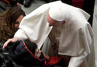 Papa Francesco saluta un fedele al termine dell'Udienza Generale del mercoledi' in aula Paolo VI in Vaticano, 28 dicembre 2016.<br /> Pope Frances greets a faithful at the end of his weekly general audience in Paul VI Hall at the Vatican on December 28, 2016.<br /> UPDATE IMAGES PRESS/Isabella Bonotto<br /> <br /> STRICTLY ONLY FOR EDITORIAL USE