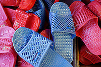 Red, pink, and blue plastic slip-on sandals for sale in Chinatown, Vancouver, British Columbia, Canada