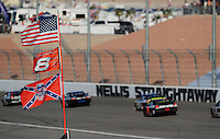 Mar. 1, 2009; Las Vegas, NV, USA; NASCAR Sprint Cup Series drivers race down the backstretch past a confederate flag during the Shelby 427 at Las Vegas Motor Speedway. Mandatory Credit: Mark J. Rebilas-