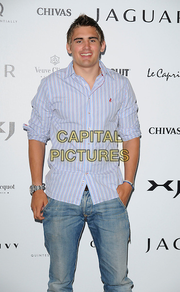 TOBY FLOOD.The New Jaguar XJ launch party, Saatchi Gallery, Duke of York's HQ, London, England..July 9th, 2009.half length 3/4 blue striped stripes shirt jeans denim hand in pocket .CAP/CAN.©Can Nguyen/Capital Pictures.