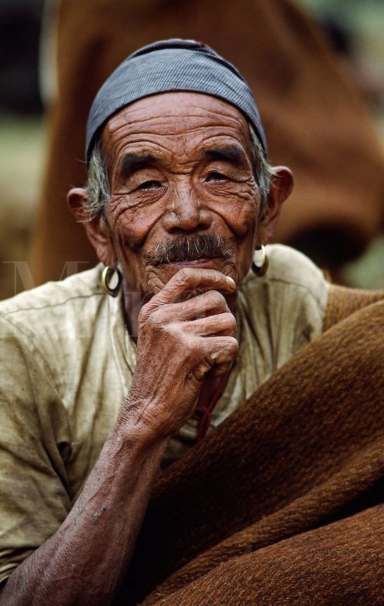 OLD GURUNG MAN with golden EARRINGS in the DORDI RIVER VALLEY - BODHA HIMAL, NEPAL