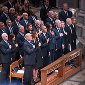 Dignitaries pay their respects as the casket containing the remains of the late former United States President George H.W. Bush at the National funeral service in his honor at the Washington National Cathedral in Washington, DC on Wednesday, December 5, 2018.  Front row: United States President Donald J. Trump, first lady Melania Trump, former US President Barack Obama, former US President Bill Clinton, former US Secretary of State Hillary Rodham Clinton, former US President Jimmy Carter, former first lady Rosalynn Carter.  Second row: US Vice President Mike Pence, Karen Pence, former US Vice President Dan Quayle, Marilyn Quayle, former US Vice President Dick Cheney, Lynne Cheney, former US Vice President Joe Biden, Jill Biden, former US Vice President Al Gore. <br /> Credit: Ron Sachs / CNP<br /> (RESTRICTION: NO New York or New Jersey Newspapers or newspapers within a 75 mile radius of New York City)
