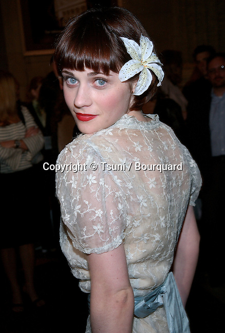 Zooey Deschanel posing at the premiere of Big Trouble at El Captain Theatre in Los Angeles. April 2, 2002.