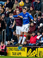 26th January 2020, Tynecastle Park, Edinburgh, Scotland; Scottish Premier League football, Hearts of Midlothian versus Rangers; Aidan White of Hearts and Jon Flanagan of Rangers challenge for a header