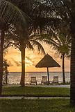 ZANZIBAR, Paje Beach, Beach Chairs and Umbrella on the beach during Sunset. view from Baraza Hotel