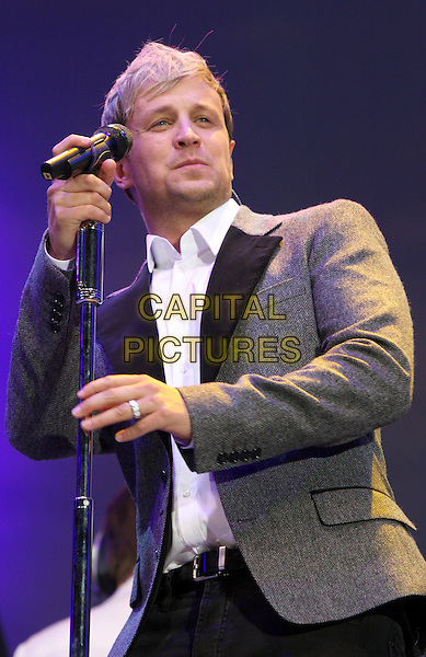 WESTLIFE - KIAN EGAN.BBC Proms in the Park at Hyde Park, London, England..September 10th 2011.stage concert live gig performance music half length white shirt black suit jacket grey gray lapels .CAP/ROS.©Steve Ross/Capital Pictures