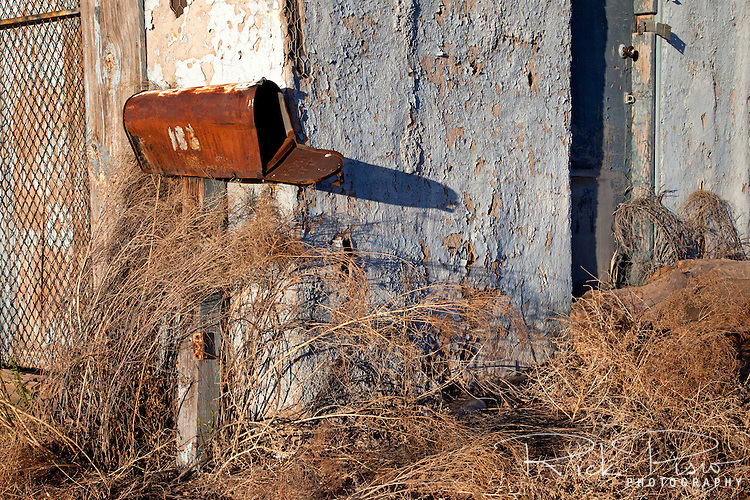 Rusted mailbox and weathered building, Holbrook, Arizona
