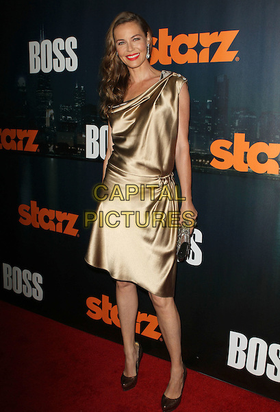 Connie Nielsen.Starz Series 'Boss' season premiere  at At The ArcLight Cinemas, Hollywood, California, USA 6th October 2011..full length dress gold  brown shoes clutch bag  red lipstick silk satin  .CAP/ADM/KB.©Kevan Brooks/AdMedia/Capital Pictures.