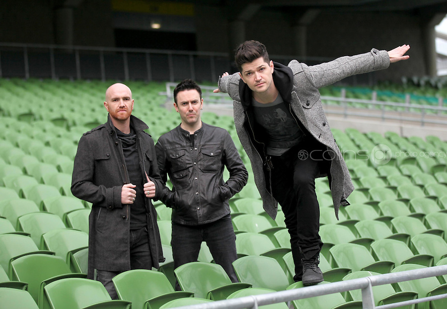 "NO REPRO FEE: 1.12.2011: Irish trio The Script pictured at the Aviva Stadium Dublin to mark the release of their first concert DVD ""HOMECOMING: LIVE AT THE AVIVIA STADIUM DUBLIN"" filmed by acclaimed director Dick Carruthers ( Oasis, White Stripes, Paul McCartney.) 98FM's Thunder Trio Jeri Mahon, Mary Scott and Angela Frawley joined band members Danny, Mark and Glen reliving the experience of playing on home turf to a 54,000 strong crowd! The Script were back in Dublin earlier this year on July 2nd  to play the sold-out show, the event that marked the pinnacle of the band's career to date coming just 3 years after their 1st gig at Dublin's Sugar Club in front of 28 people. The DVD is of the entire concert, includes their hits ""The Man Who Can't be Moved"", ""Nothing"" and ""Breakeven."" Pictured (l-r) at the DVD launch were Script band members Glen Power, Mark Sheehan and Danny O'Donoghue. Picture Collins."