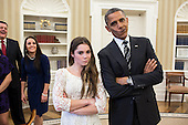 """United States President Barack Obama jokingly mimics U.S. Olympic gymnast McKayla Maroney's """"not impressed"""" look while greeting members of the 2012 U.S. Olympic gymnastics teams in the Oval Office, Nov. 15, 2012. Steve Penny, USA Gymnastics President, and Savannah Vinsant laugh at left. .Mandatory Credit: Pete Souza - White House via CNP"""