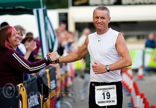 08 AUG 2010 - LICHFIELD, GBR - Paul Thompson celebrates his victory in the Triple Iron race at the Enduroman Ultra Triathlon Championships in a time of 37 hours 55 minutes and 19 seconds (PHOTO (C) NIGEL FARROW)