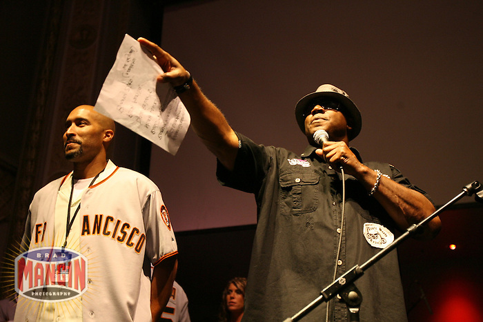 SAN FRANCISCO - May 24:  Barry Bonds of the San Francisco Giants auctions off a Giants jersey belonging to Randy Winn (left) at a charity jam concert Barry Zito organized to benefit two non-profits at Ruby Skye nightclub in San Francisco, California on May 24, 2007.  Photo by Brad Mangin