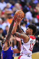 Rookie Kelly Oubre, Jr. of the Wizards shoots against Knicks' Derrick Williams.  New York defeated Washington 115-104 during a NBA preseason game at the Verizon Center in Washington, D.C. on Friday, October 9, 2015.  Alan P. Santos/DC Sports Box