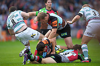 130712 Copyright onEdition 2012 ©.Free for editorial use image, please credit: onEdition..Will Skinner of Harlequins (centre) clears Darren Allinson of London Irish out of the ruck at The Stoop, Twickenham in the first round of The J.P. Morgan Asset Management Premiership Rugby 7s Series...The J.P. Morgan Asset Management Premiership Rugby 7s Series kicked off again for the third season on Friday 13th July at The Stoop, Twickenham with Pool B being played at Edgeley Park, Stockport on Friday, 20th July, Pool C at Kingsholm Gloucester on Thursday, 26th July and the Final being played at The Recreation Ground, Bath on Friday 3rd August. The innovative tournament, which involves all 12 Premiership Rugby clubs, offers a fantastic platform for some of the country's finest young athletes to be exposed to the excitement, pressures and skills required to compete at an elite level...The 12 Premiership Rugby clubs are divided into three groups for the tournament, with the winner and runner up of each regional event going through to the Final. There are six games each evening, with each match consisting of two 7 minute halves with a 2 minute break at half time...For additional images please go to: http://www.w-w-i.com/jp_morgan_premiership_sevens/..For press contacts contact: Beth Begg at brandRapport on D: +44 (0)20 7932 5813 M: +44 (0)7900 88231 E: BBegg@brand-rapport.com..If you require a higher resolution image or you have any other onEdition photographic enquiries, please contact onEdition on 0845 900 2 900 or email info@onEdition.com.This image is copyright the onEdition 2012©..This image has been supplied by onEdition and must be credited onEdition. The author is asserting his full Moral rights in relation to the publication of this image. Rights for onward transmission of any image or file is not granted or implied. Changing or deleting Copyright information is illegal as specified in the Copyright, Design and Patents Act 1988. If you are in any way unsure of your righ
