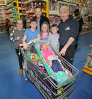 Pictured: Gylfi Sigurdsson Wednesday 08 December 2016<br />Re: Swansea City FC players have bought Christmas gifts for 60 children at Smyths toy store in Swansea, south Wales.