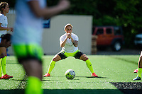 Seattle, WA - Sunday, April 17, 2016: Seattle Reign FC midfielder Jessica Fishlock (10), stretches prior to the match at Memorial Stadium. Sky Blue FC defeated the Seattle Reign FC 2-1 during a National Women's Soccer League (NWSL) match at Memorial Stadium.