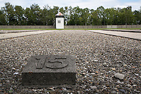 Germany. Bayern state. The Dachau Concentration Camp Memorial Site. Former location of the barack, number 15 which are marked by foundations. The ground plan of the camp, still recognizable today and characterized by its symmetrical alignment and functional divisions, was also used in almost all other concentration camps.The camp fencing ( partly reconstructed in 1965) was made-up of grass, strips, ditches with an electrified barbed-wire fence and the camp wall. SS men guarded the camp grounds from seven towers. On march 22, 1933, the first concentration camp was opened in Dachau by the Nazis. It became a model for all later concentration camps established under the control of the SS men and the Third  Reich. © 2007 Didier Ruef