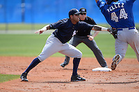 Shortstop Cito Culver (2) of the New York Yankees organization tags out Rowdy Tellez (44) during a minor league spring training game against the Toronto Blue Jays on March 16, 2014 at the Englebert Minor League Complex in Dunedin, Florida.  (Mike Janes/Four Seam Images)
