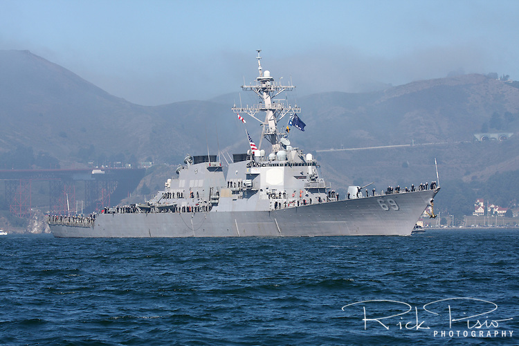 The Arleigh Burke class Aegis guided missile destroyer USS Milius (DDG-69) enters San Francisco Bay. The Milius is named after Commander Paul L. Milius (1928-1968) of U.S. Navy squadron VO-67 whose aircraft was hit over Laos in 1968 and after ordering his crew to bail out he exited the aircraft himself but he was never recovered. Commander Milius recieved the Navy Cross in 1968.