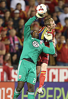 Goalie Bill Hamid #28 (l) of D.C. United knocks the ball away from Nat Borchers #6 of of Real Salt Lake during the second half of the U.S. Open Cup Final on October  1, 2013 at Rio Tinto Stadium in Sandy, Utah. DC United beat Real Salt Lake 1-0 to win the championship.