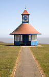 Seaside shelter and clock tower by the sea on the Greensward, Frinton on Sea, Essex, england