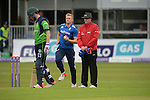 David Willey between batsman Andrew Balbairne and Umpire Ian Ramage at the Ireland v England One Day Cricket International held at Malahide Cricket Club, Dublin, Ireland. 8th May 2015.<br /> Photo: Joe Curtis/www.newsfile.ie