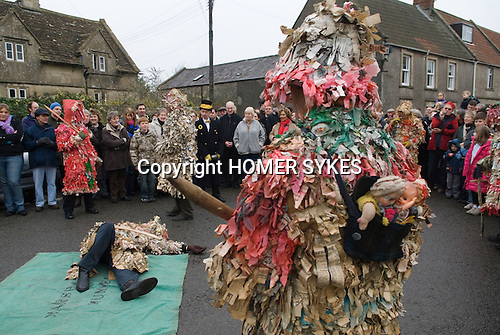 Marshfield Mummers, Boxing Day performance, Gloucestershire, England. 2006. Littel Man John lies slain on the floor by King William. Father Christmas in red. Little Jolly Jack with his family on his back.