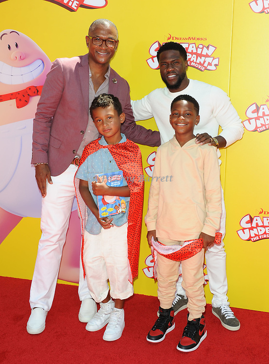 Kevin Hart and son and Tommy Davidson with his son arriving at the Los Angeles premiere of Captain Underpants, held at the Regency Village Theater in Westwood California on May 21, 2017