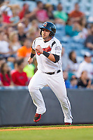 Caleb Gindl (13) of the Nashville Sounds scores a run in the bottom of the 3rd inning against the Oklahoma City RedHawks at Greer Stadium on July 25, 2014 in Nashville, Tennessee.  The Sounds defeated the RedHawks 2-0.  (Brian Westerholt/Four Seam Images)