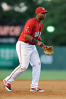 Third baseman Rafael Devers (13) of the Greenville Drive plays the infield in a game against the Charleston RiverDogs on Saturday, May 23, 2015, at Fluor Field at the West End in Greenville, South Carolina. Devers is the No. 6 prospect of the Boston Red Sox, according to Baseball America. Charleston won 5-4. (Tom Priddy/Four Seam Images)