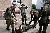 Young Polish soldiers having fun during cigarette break at the military base in Bartoszyce, Poland, May 2008.<br />