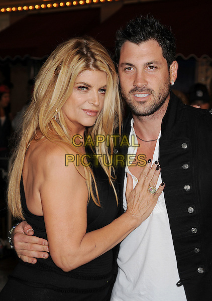 "KIRSTIE ALLEY & MAKSIM CHMERKOVSKIY.arriving at the World Premiere of ""Pirates Of The Caribbean: On Stranger Tides"" at Disneyland in Anaheim, California, USA, .May 7th, 2011..4 four half length messy hair roots make-up  black dress one shoulder white arm around jacket   .CAP/ROT/TM.©TM/ROT/Capital Pictures"