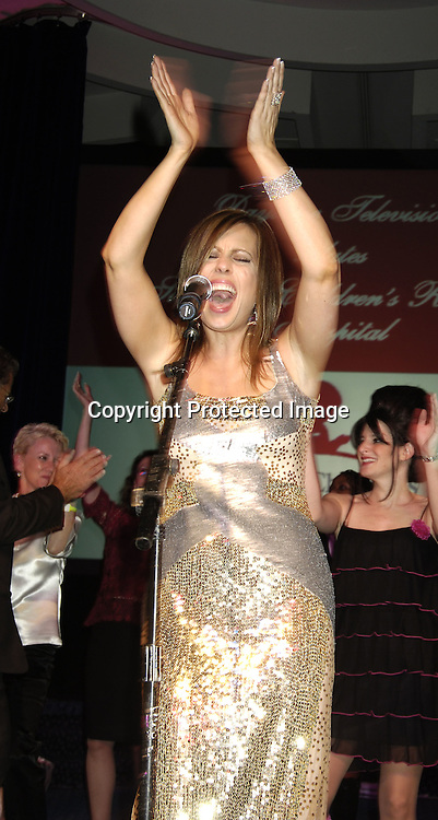 Martha Byrne of As The World Turns singing ..at the 11th Annual Daytime Television Salutes St. Jude Children's Research Hospital benefit hosted by Martha Byrne on October 14, 2005 at The New York Marriott Marquis Hotel. ..Photo by Robin Platzer, Twin Images