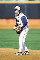 Georgetown Hoyas second baseman Jake Kuzbel (14) on defense against the Marshall Thundering Herd at Wake Forest Baseball Park on February 15, 2014 in Winston-Salem, North Carolina.  The Thundering Herd defeated the Hoyas 5-1.  (Brian Westerholt/Four Seam Images)