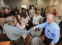 NWA Democrat-Gazette/ANDY SHUPE<br /> Gordon Whitbeck (right), president and microbiologist of Whitbeck Labs in Springdale, shakes hands with visitors Wednesday, Jan. 18, 2017, during a grand opening celebration for the newly constructed office and laboratory for the longtime poultry testing company in Springdale .