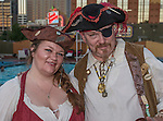 Emily Gonzales and Sam Tower with Pirates of Reno during the Pirate Crawl held in downtown Reno on Saturday night, August 13, 2016.