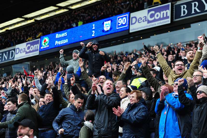 Preston North End fans celebrate their 1-2 win over Blackburn Rovers at the final whistle <br /> <br /> Photographer Chris Vaughan/CameraSport<br /> <br /> Football - The Football League Sky Bet Championship - Blackburn Rovers v Preston North End - Saturday 2nd April 2016 - Ewood Park - Blackburn<br /> <br /> &copy; CameraSport - 43 Linden Ave. Countesthorpe. Leicester. England. LE8 5PG - Tel: +44 (0) 116 277 4147 - admin@camerasport.com - www.camerasport.com