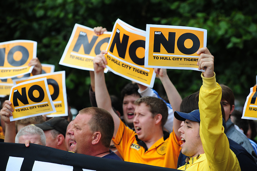 Hull City fans protest against the proposed name change of their club outside the ground<br /> <br />  (Photo by Chris Vaughan/CameraSport) <br /> <br /> Football - Barclays Premiership - Hull City v Norwich City - Saturday 24th August 2013 - Kingston Communications Stadium - Hull<br /> <br /> &copy; CameraSport - 43 Linden Ave. Countesthorpe. Leicester. England. LE8 5PG - Tel: +44 (0) 116 277 4147 - admin@camerasport.com - www.camerasport.com