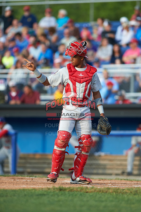 Auburn Doubledays catcher Jeyner Baez (13) signals two outs during a game against the Batavia Muckdogs on June 19, 2017 at Dwyer Stadium in Batavia, New York.  Batavia defeated Auburn 8-2 in both teams opening game of the season.  (Mike Janes/Four Seam Images)