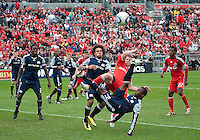 22 May 2010: New England Revolution midfielder Sainey Nyassi #14 attempts a bicycle kick to clear a ball during a game between the New England Revolution and Toronto FC at BMO Field in Toronto..Toronto FC won 1-0.....