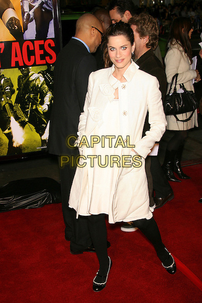 "AMANDA PEET.""Smokin' Aces"" World Premiere - Arrivals presented by Universal Pictures and Working Title held at the Grauman's Chinese Theater, Hollywood, California, USA..January 18th, 2007.full length white coat hand in pocket flower corsage pregnant.CAP/ADM/ZL.©Zach Lipp/AdMedia/Capital Pictures"