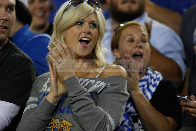 A fan cheers for UK during the first half of the UK football game against Florida at Commonwealth Stadium in Lexington, Ky., on Saturday, September 28, 2013. Photo by Eleanor Hasken | Staff