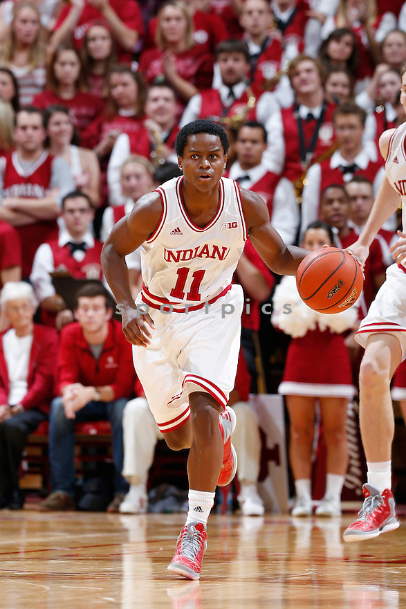 BLOOMINGTON, IN - NOVEMBER 9: Kevin (Yogi) Ferrell #11 of the Indiana Hoosiers brings the ball up court against the Bryant Bulldogs during the game at Assembly Hall on November 9, 2012 in Bloomington, Indiana. The Hoosiers won 97-54. Kevin (Yogi) Ferrell
