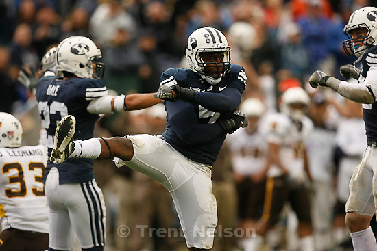 Trent Nelson     The Salt Lake Tribune.BYU defensive back Brandon Bradley (5) celebrates after knocking the ball away on Wyoming's second-to-last play of the game, BYU vs. Wyoming, college football Saturday, October 23, 2010 at LaVell Edwards Stadium in Provo. BYU won 25-20.