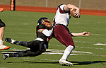 WATERTOWN, CT-112317JS14- Torrington's Ora Curry (11) gets dragged down by Watertown's Richard Ojeda (1) during their Thanksgiving Day game Thursday at Watertown High School. <br /> Jim Shannon Republican-American