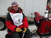 Jon Little.Doug Swingley takes a seat on his new sled before the ceremonial start, March 4, 2006