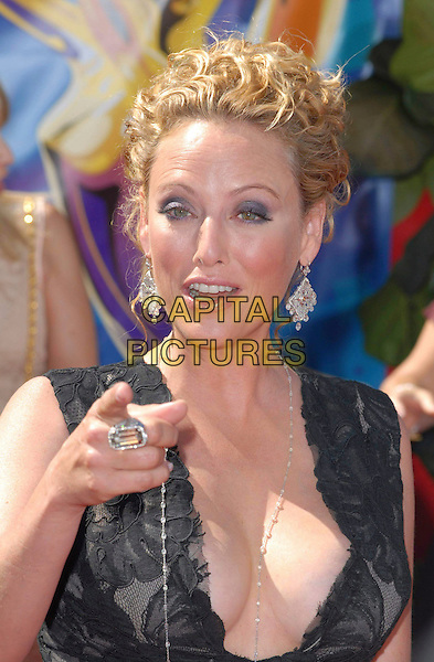 VIRGINIA MADSEN.58th Annual Primetime Emmy Awards held at the Shrine Auditorium, Los Angeles, California, USA..August 27th, 2006.Ref: ADM/CH.headshot portrait plunging neckline pointing.www.capitalpictures.com.sales@capitalpictures.com.©Charles Harris/AdMedia/Capital Pictures.